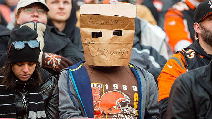 cleveland browns fan wears paper bag over his head while ashamed of his team
