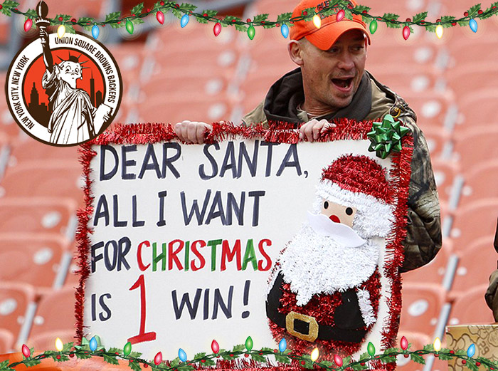 Cleveland Browns fan holding Christmas Santa sign